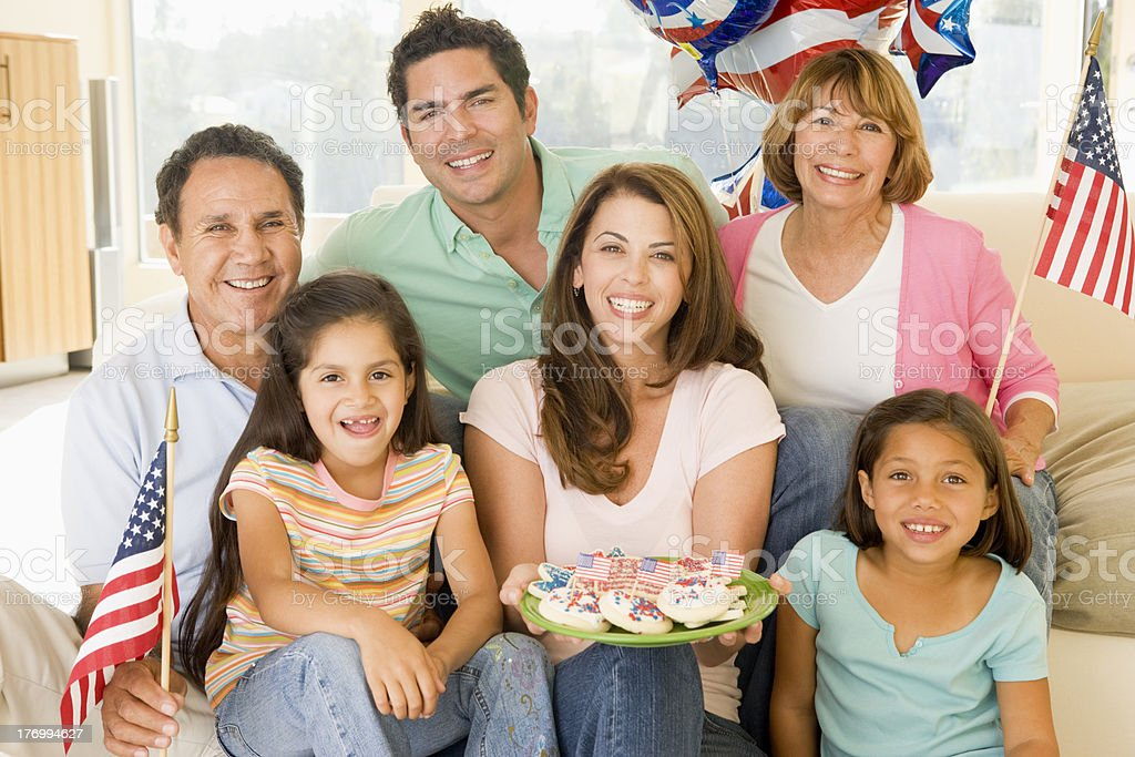 Family in living room on 4th of July smiling royalty-free stock photo