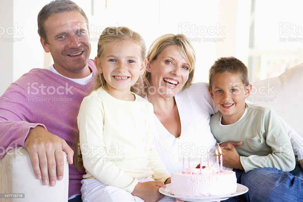 Family in living room with cake smiling royalty-free stock photo