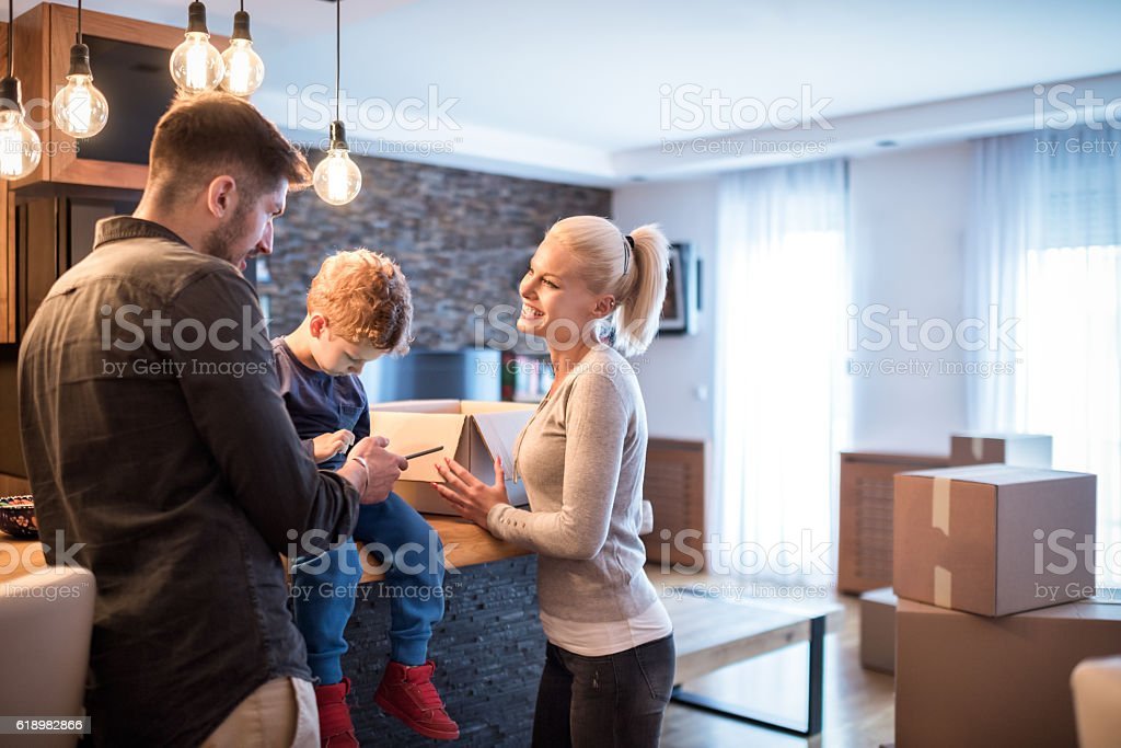 Family in new house stock photo