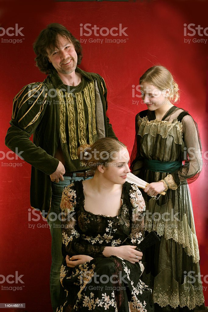 Family in old time dresses royalty-free stock photo