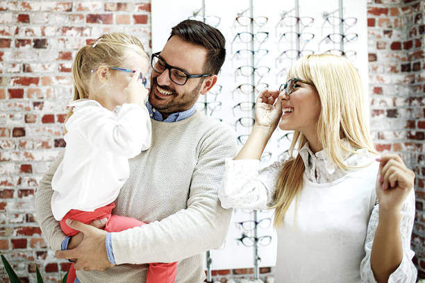 family in optics store - optical instrument stock pictures, royalty-free photos & images