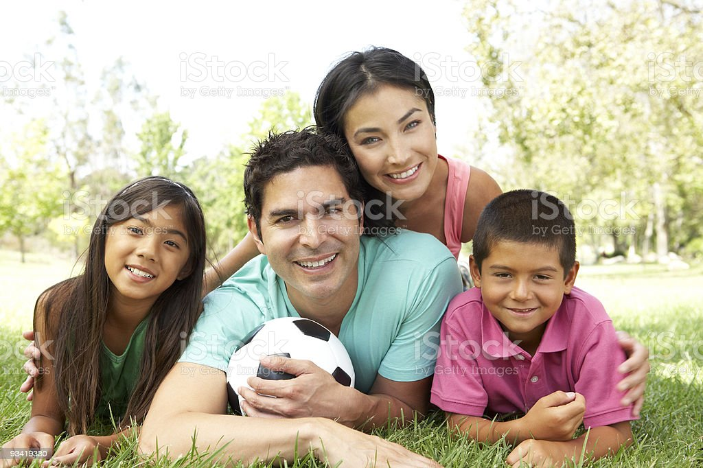 Family In Park With Football royalty-free stock photo