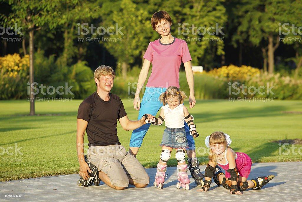 Family in roller skates stock photo