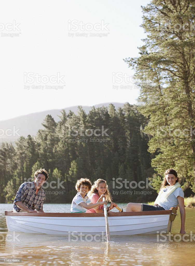 Family in rowboat on lake royalty-free stock photo
