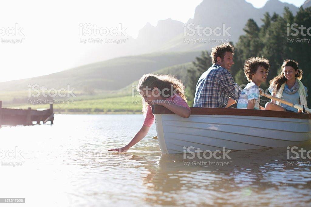Family in rowboat on lake stock photo