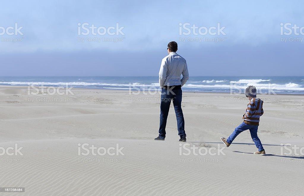 family in sand dunes stock photo