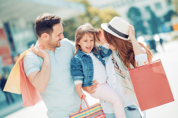 family in shopping - shopping stock photos and pictures