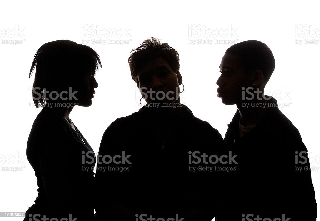family in silhouette stock photo