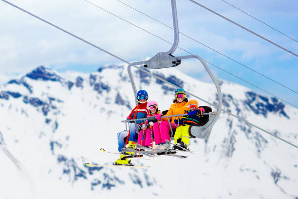 Family in ski lift in mountains skiing with kids picture id1068935366?b=1&k=6&m=1068935366&s=612x612&w=0&h=zppsjmq0a9u uvtght8yw uxlqseudq8yeli9g7b75m=
