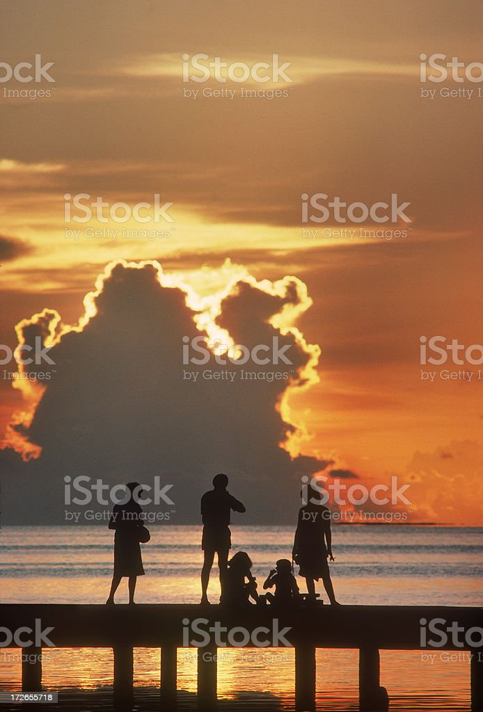 Family in sunset French Polynesia royalty-free stock photo