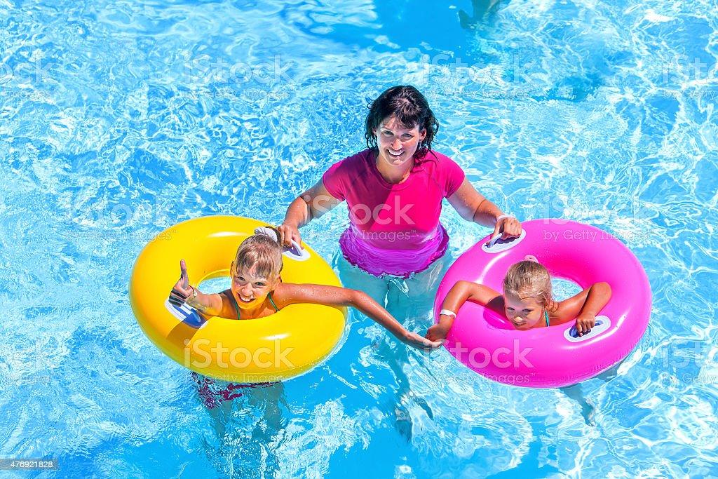 Family in swimming pool stock photo