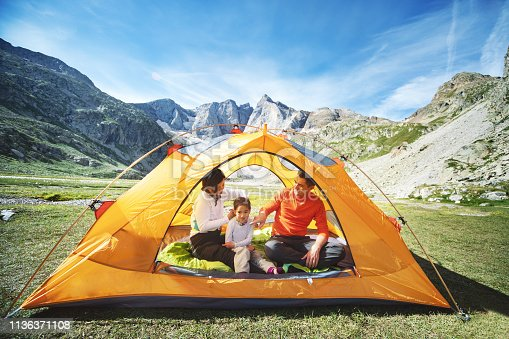 istock Family in tent in mountains 1136371108
