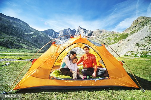 istock Family in tent in mountains 1136371277