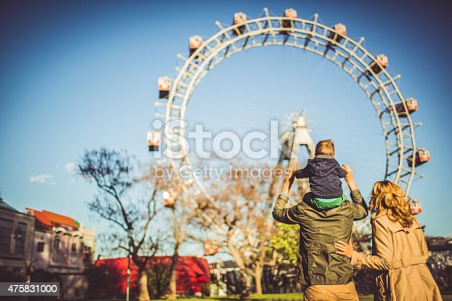 istock Family in the amusement park 475831000