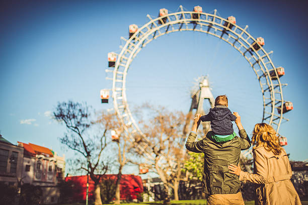 family in the amusement park - traditional festival stock photos and pictures