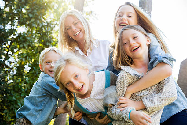 Family in the backyard playing. stock photo