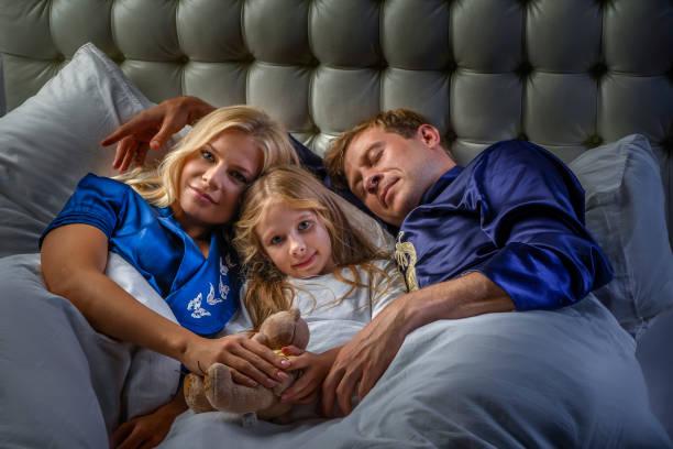 Family in the bedroom stock photo