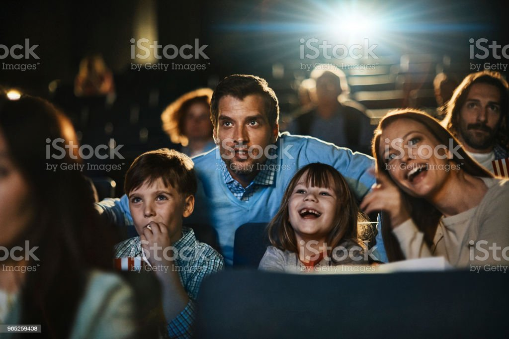 Family in the cinema royalty-free stock photo