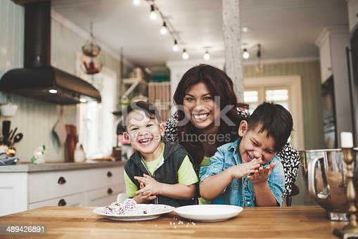 istock Family in the kitchen baking 489426891