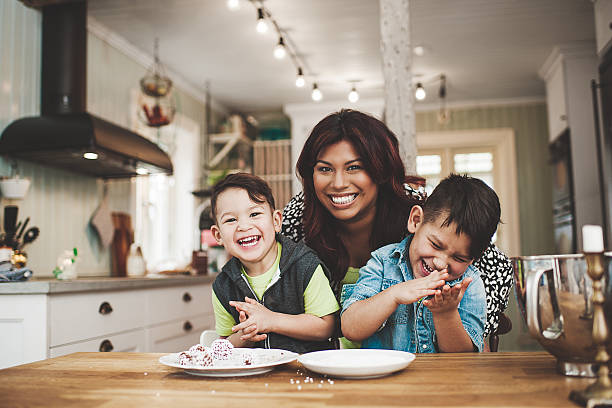 family in the kitchen baking - peruvian ethnicity stock pictures, royalty-free photos & images