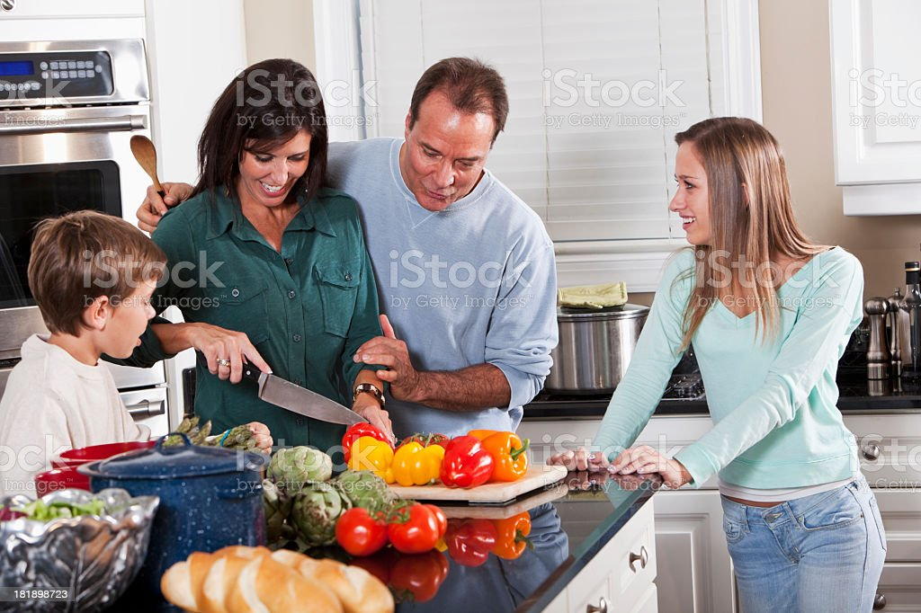 Family in the kitchen royalty-free stock photo