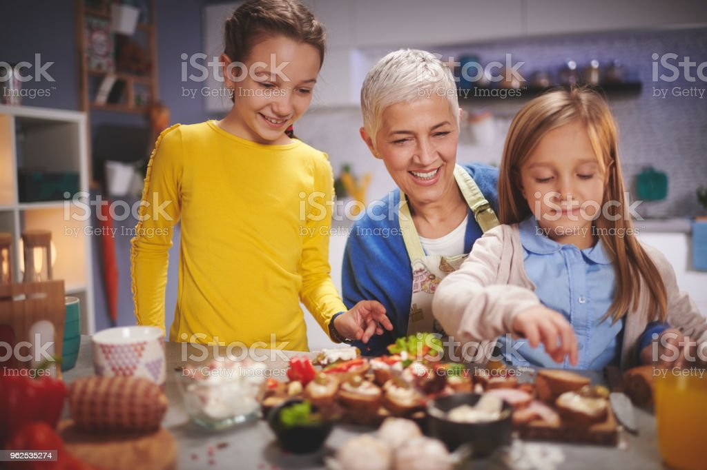 Family in the kitchen - Royalty-free Active Seniors Stock Photo