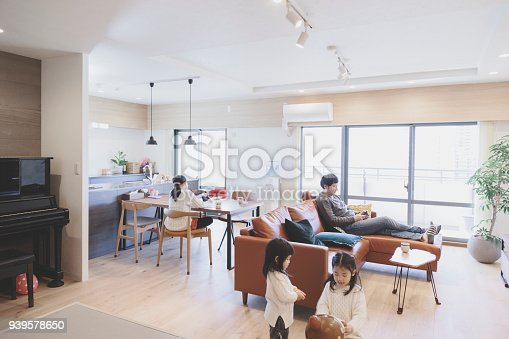 1152545468 istock photo Family in the living room at home 939578650