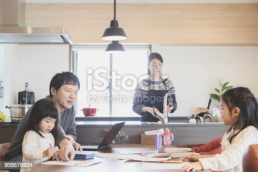 1152545468 istock photo Family in the living room at home 939578834