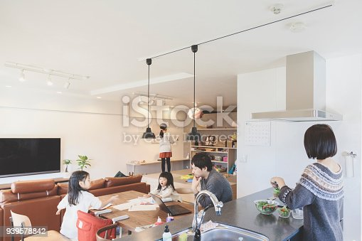 1152545468 istock photo Family  in the living room at home 939578842