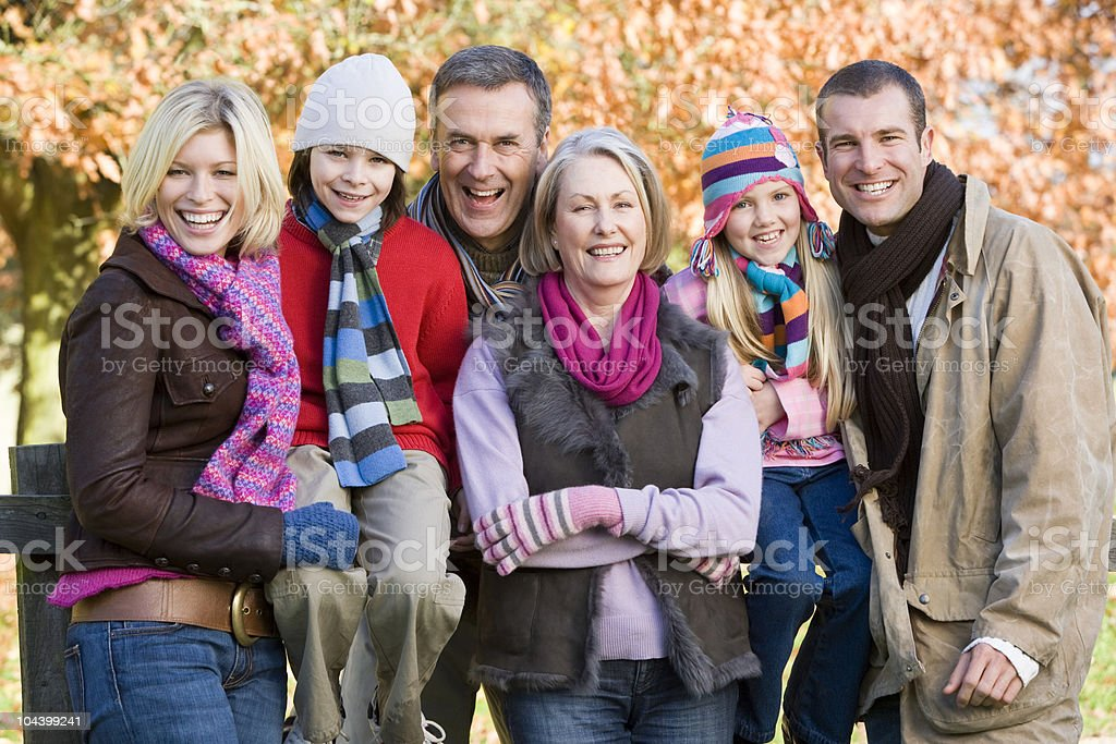 A family in the park on an autumn day royalty-free stock photo