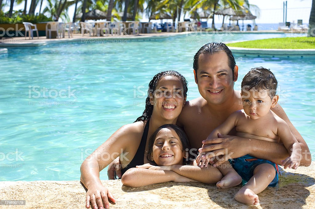 Family in the pool royalty-free stock photo