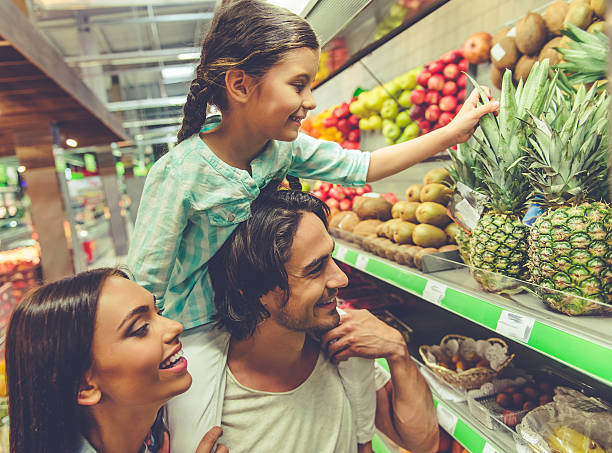 family in the supermarket - happy person buy appliances stock photos and pictures