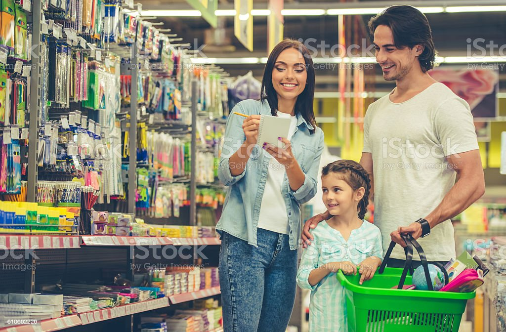 Family in the supermarket stock photo