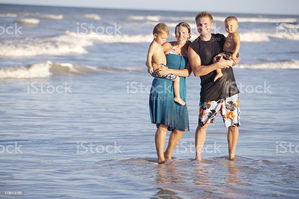 family in the surf royalty-free stock photo