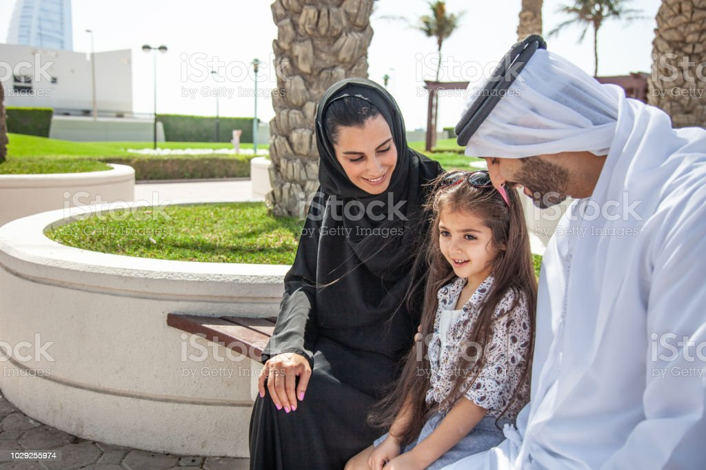Family in the UAE having fun outdoor at the public park stock photo