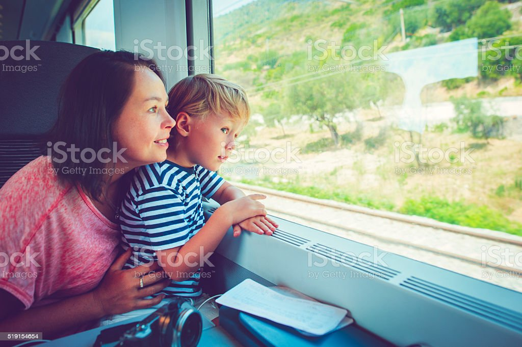 Family in train Little boy and his mother traveling in train Adult Stock Photo