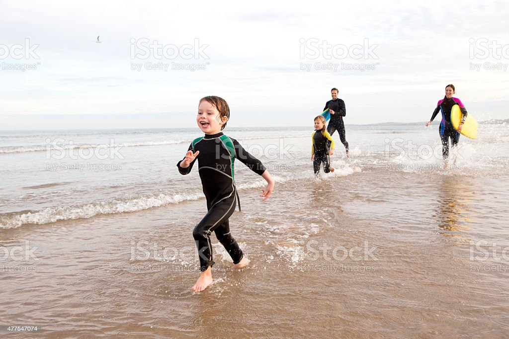 Family in Wetsuits stock photo