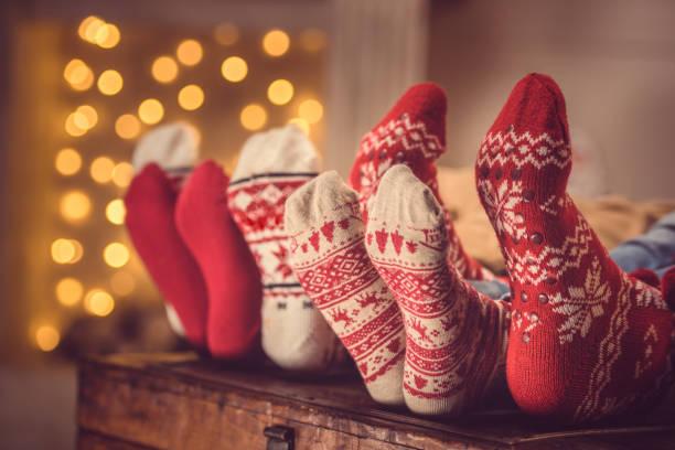 family in wool socks stock photo