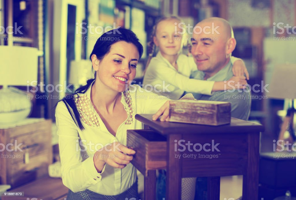Family is choosing new curbstone stock photo