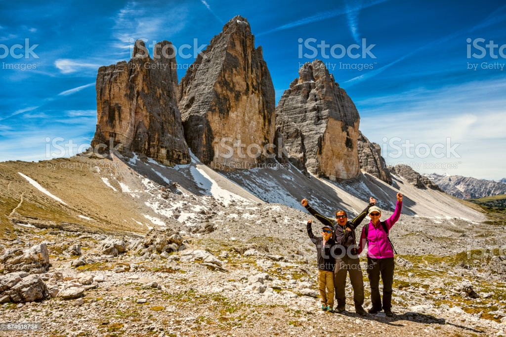 family is hiking at Tre cime di lavaredo at Dolomites in Trentino stock photo
