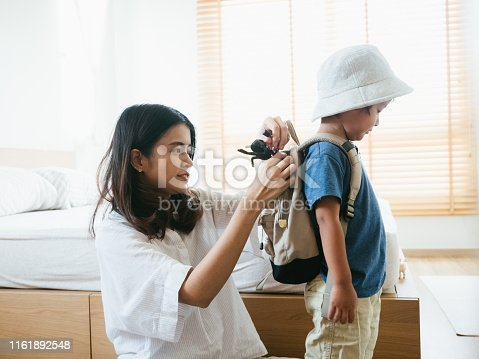 Young asian mother and son getting ready to vacation