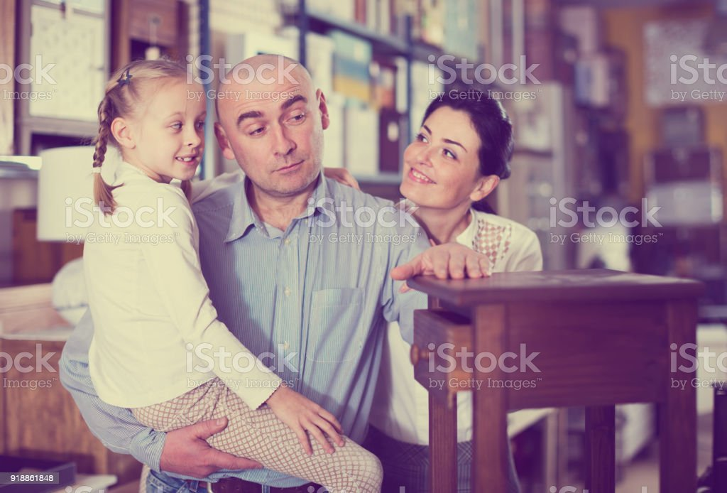 family is selecting new curbstone stock photo