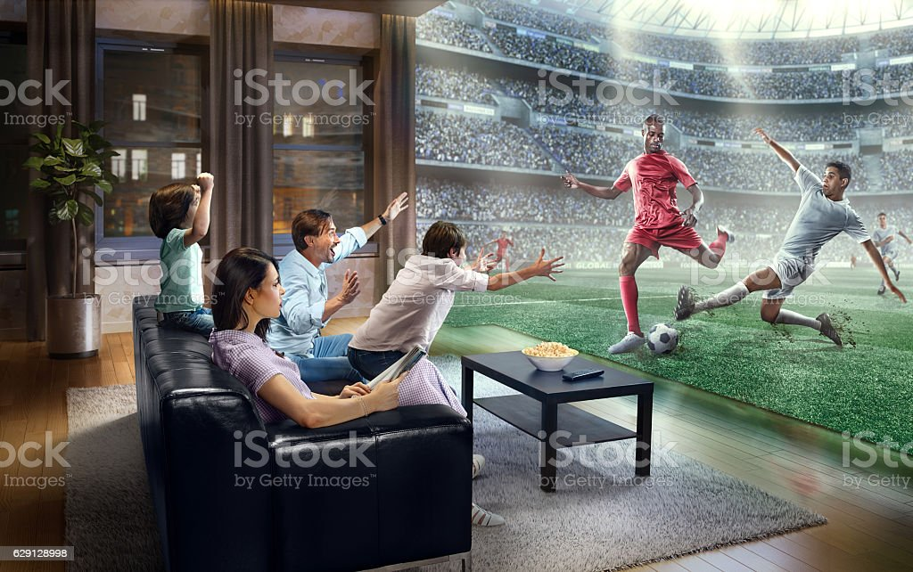 Family is watching Soccer game at home stock photo