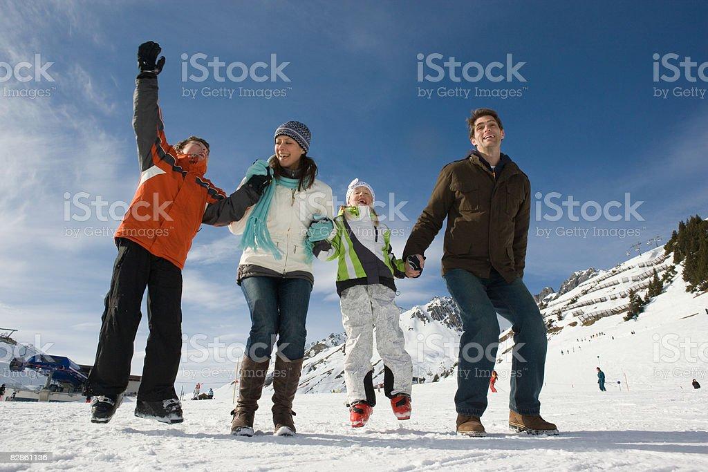 A family jumping at a ski resort royalty free stockfoto