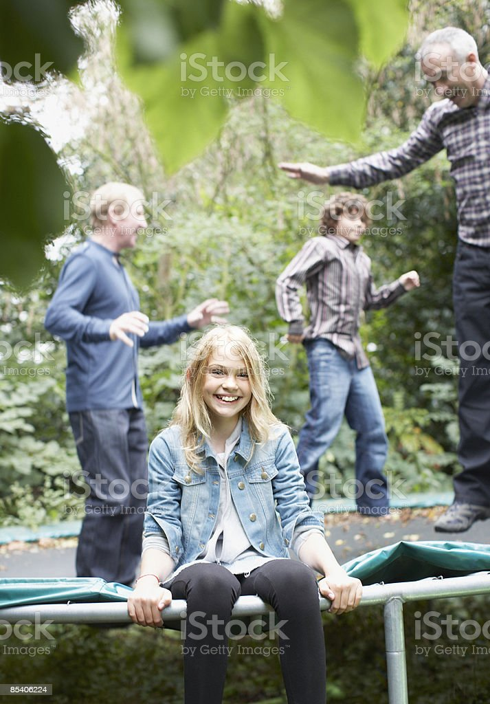 Family jumping on trampoline royalty-free stock photo