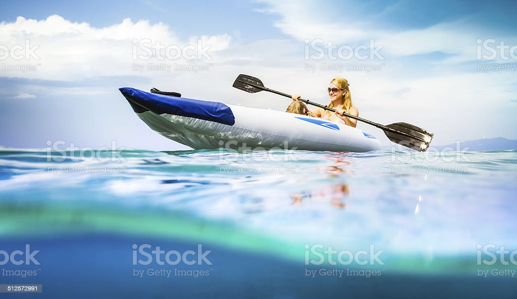 Family kayaking on sea, water level view stock photo