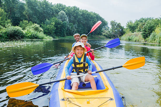 family kayaking on the river - kayaking stock pictures, royalty-free photos & images