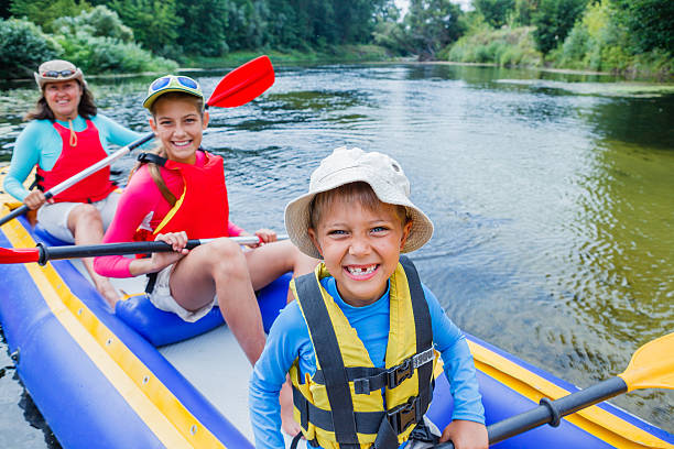 Family kayaking on the river stock photo
