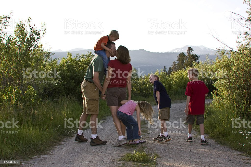 family kiss stock photo