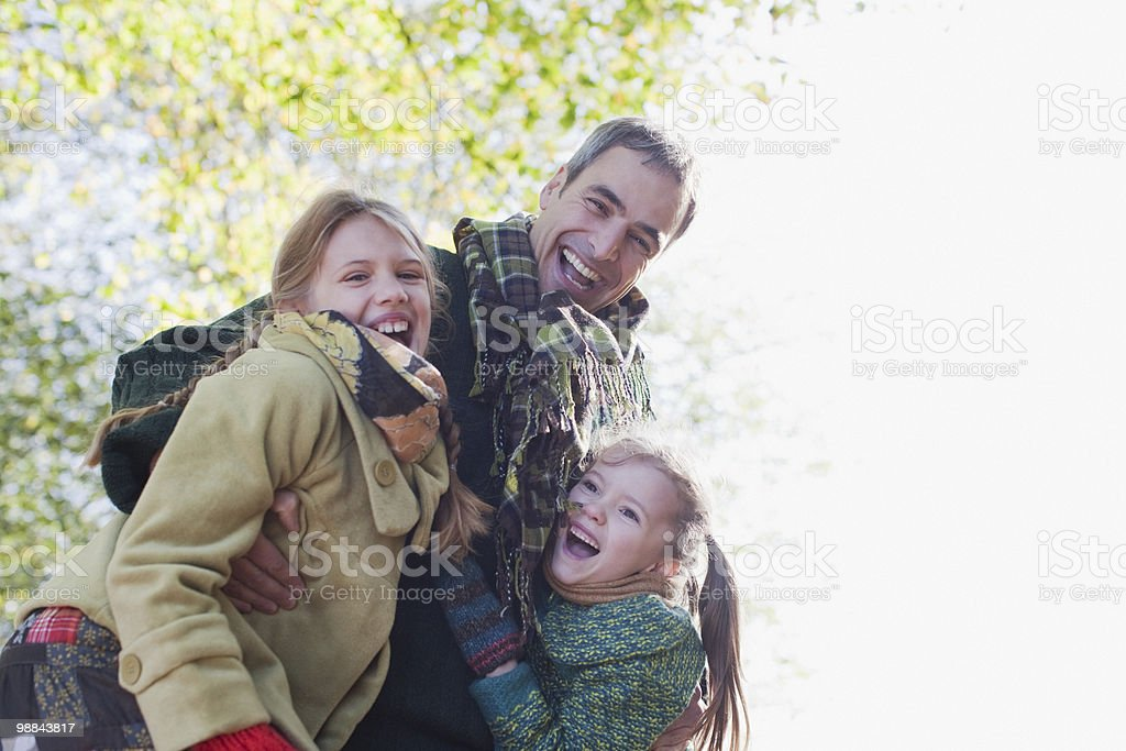 Family laughing outdoors in autumn royalty-free stock photo